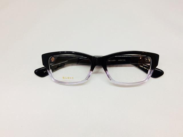 セルロイド素材の黒白ハーフレトロメガネ