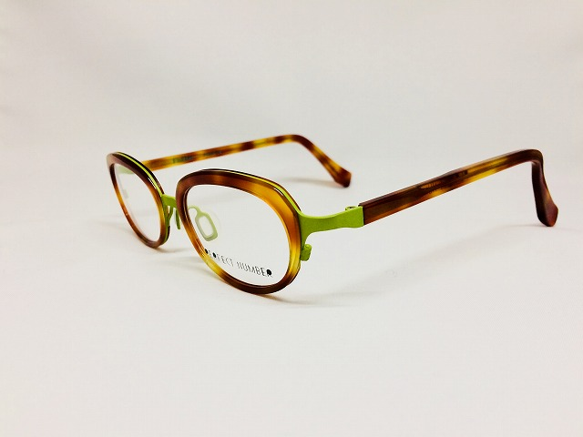 黄緑と飴色の愉快な卵型お洒落眼鏡