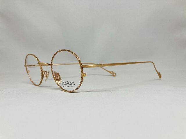 シャンパンゴールドカラーのねじねじ丸メガネ